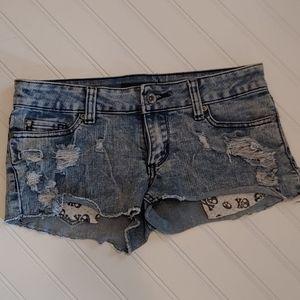 Light wash distressed peekaboo pocket skull shorts